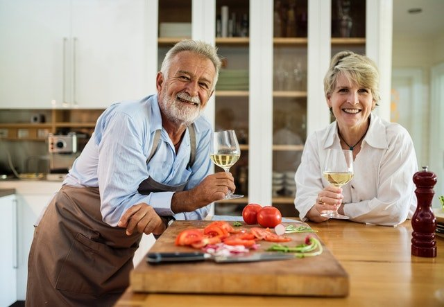 Grandparents enjoying their kitchen before selling their home